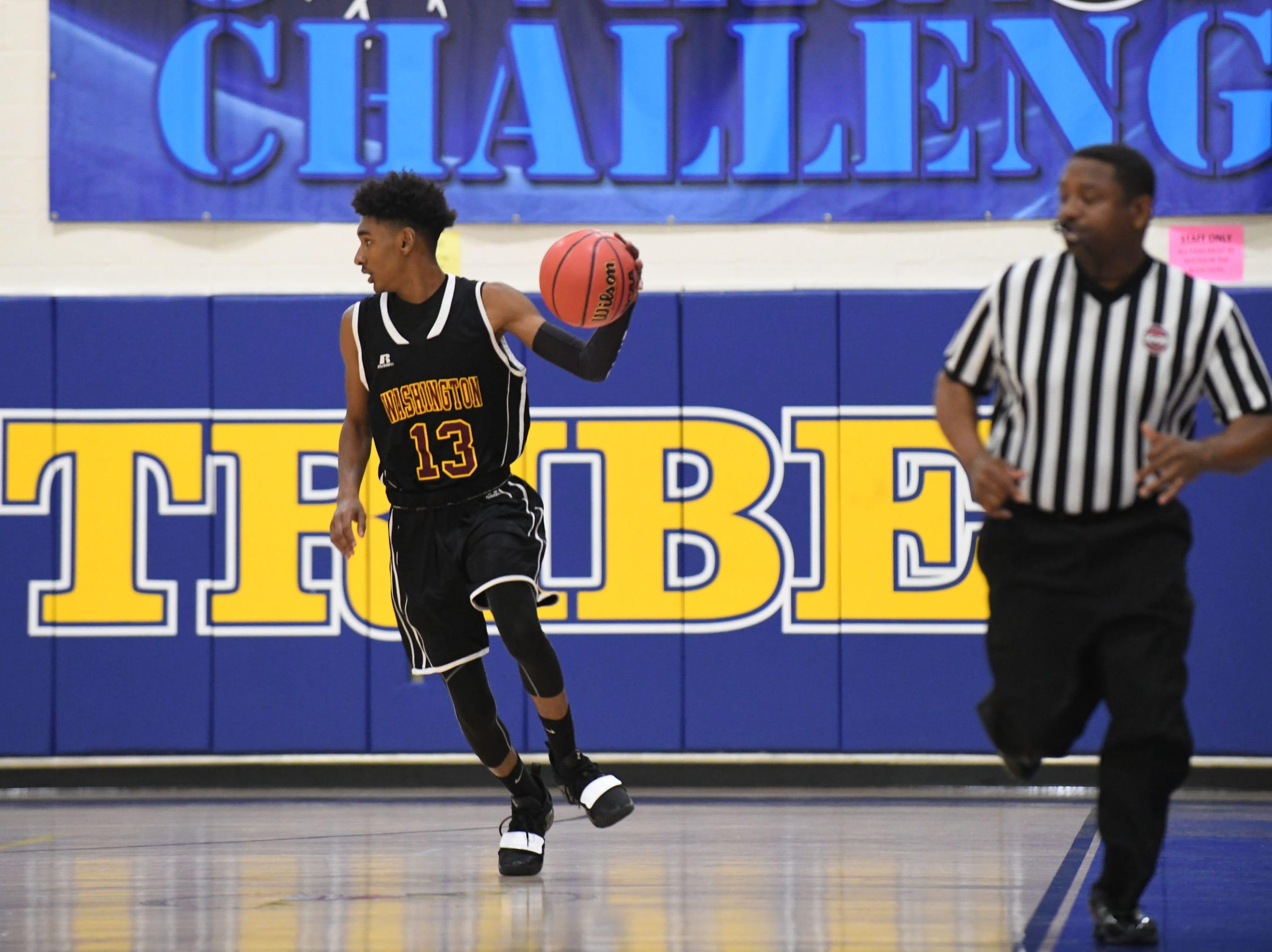Washington's Yassin Gadda brings the ball down the court against Arcadia High School on Wednesday, Dec. 26, 2018 during the Governors Challenge in Salisbury, Md.