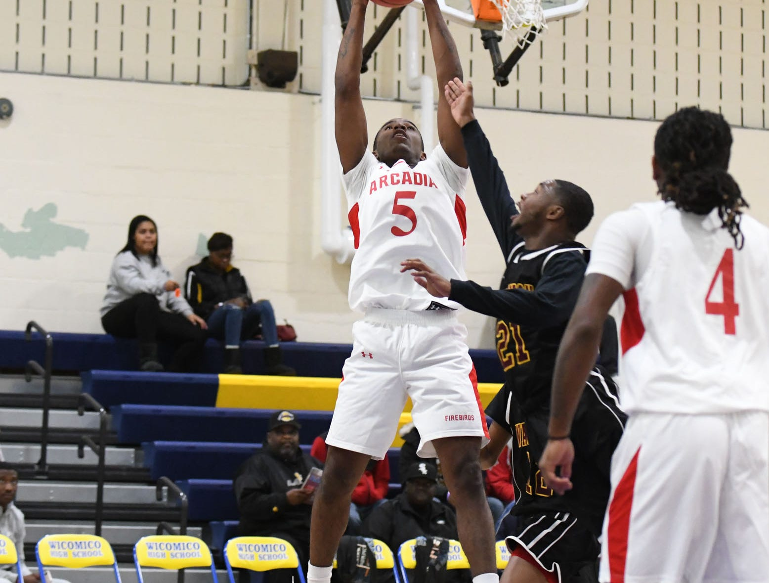 Arcadia's Lethon Williams with the rebound against Washington High School on Wednesday, Dec. 26, 2018 during the Governors Challenge in Salisbury, Md.