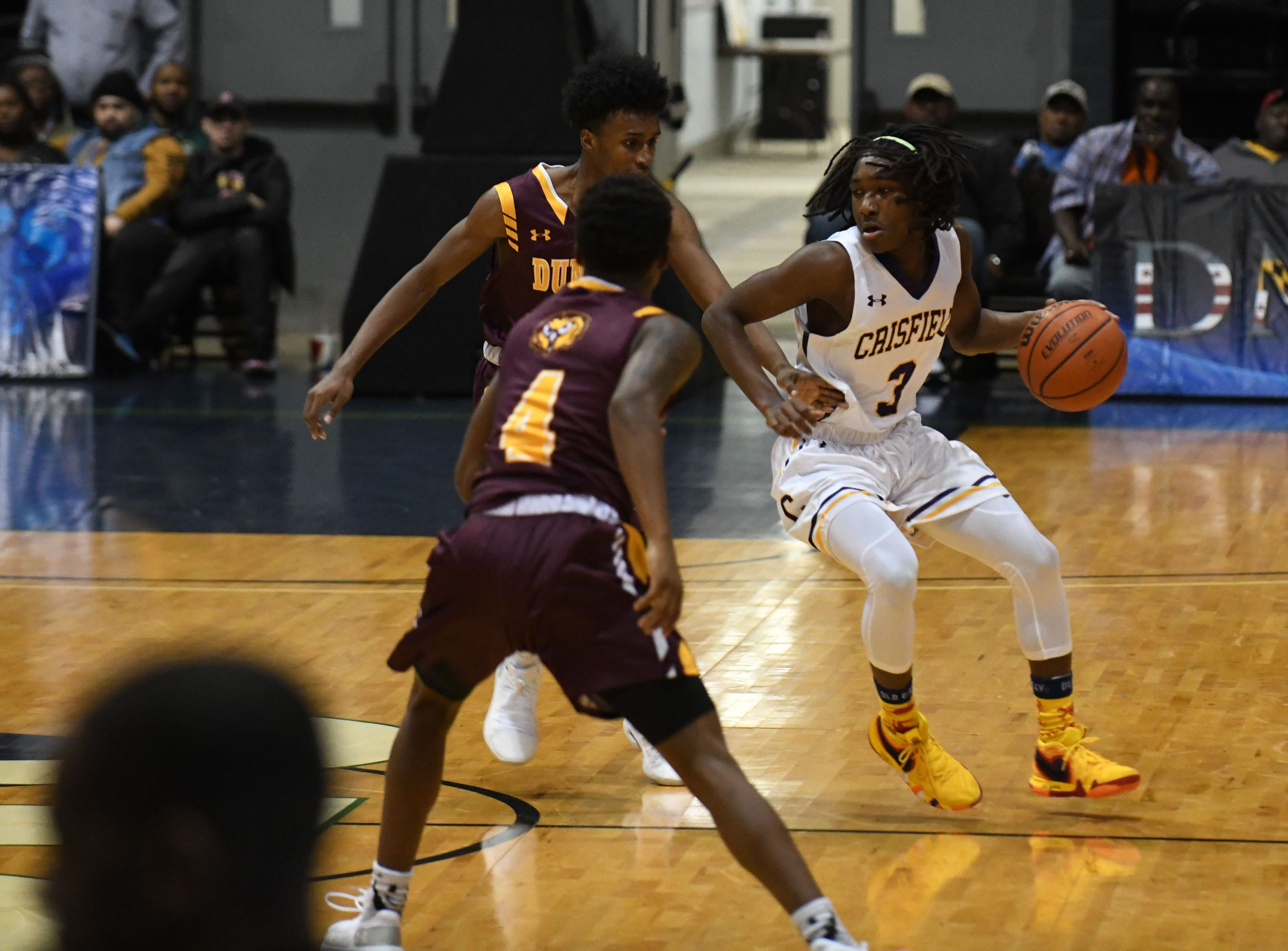 Crisfield's Ry'Kell Waters works the ball down the court against Dunbar on Thursday, Dec. 26, 2018 during the Governor's Challenge in Salisbury, Md.