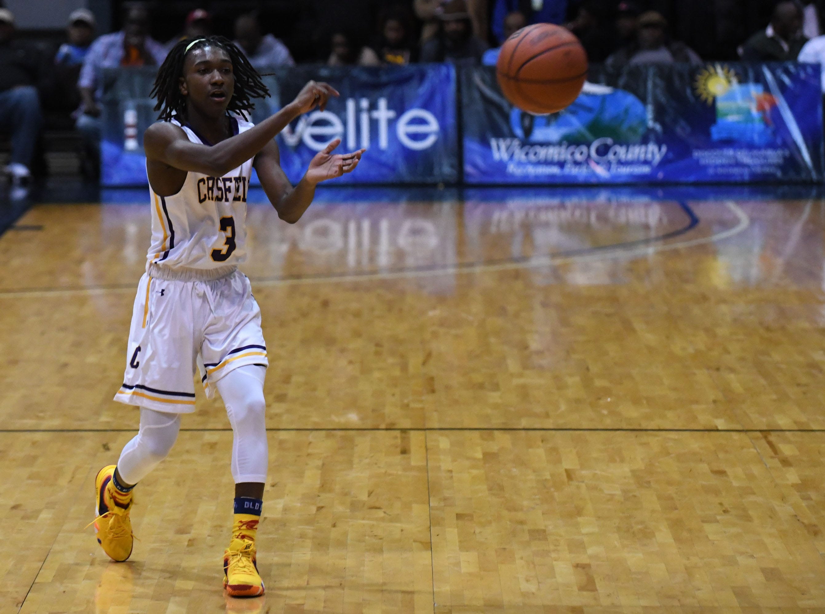 Crisfield's Ry'Kell Waters passes the ball against Dunbar on Thursday, Dec. 26, 2018 during the Governor's Challenge in Salisbury, Md.