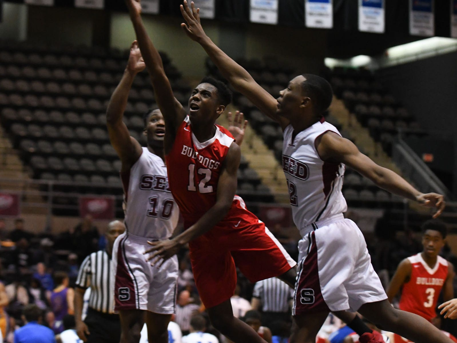 Laurel 's Deshawn Matthews with the layup against the Seed School on Wednesday, Dec. 26, 2018 during the Governors Challenge in Salisbury, Md.