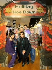 """Holiday Hoedown"" hosts included Waynette Ballengee (clockwise, from far right), Maggie Martin, Dr. Marsha Friedrich, Pam Atchison, Heidi Kallenberg, honoree Grace Poimboeuf and Linda Goldsberry."