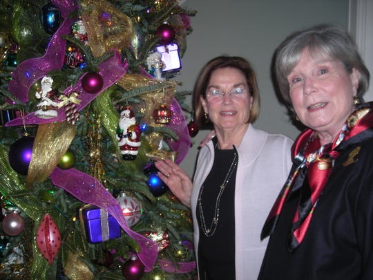 Susan Cage and Charlotte Walter at a Christmas Coffee. Guests were asked to bring a donation to benefit Louisiana Veterans Home and Woody's Veterans Home.