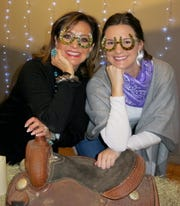 "Waynette Ballengee and ""Holiday Hoedown"" honoree Grace Poimboeuf show off horseshoe-inspired glasses."