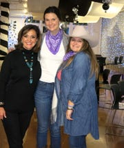 "Waynette Ballengee, honoree Grace Poimboeuf, Demoiselle Deb Mary Laura Jackson at ""Holiday Hoedown."""