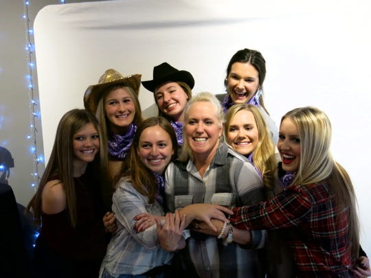 "Demoiselle Debutantes huddle up with Demoiselle Club Ball Chief Lisa Nelson at ""Holiday Hoedown"": Anne Evans, Molly Bowman, Nelson, Allyson Horton, Catherine Humphrey, Renee Lyles, Lily Huggs, Honoree Grace Poimboeuf."