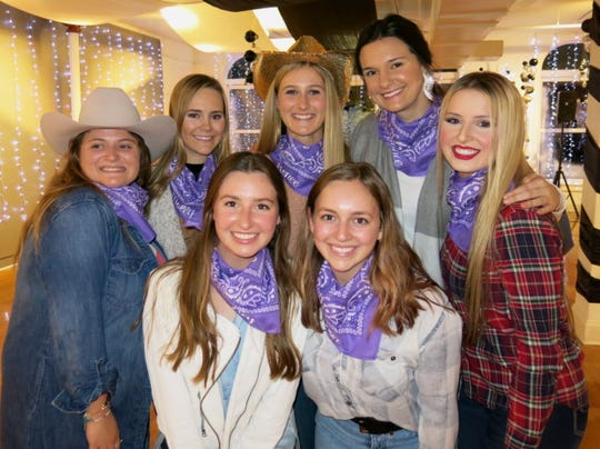 "Members of the Demoiselle Club debutante coterie at ""Holiday Hoedown"": Allyson Horton (clockwise from front row, right) Lily Huggs, Mary Laura Jackson, Molly     Bowman,  Renee Lyles, honoree Grace Poimboeuf, Anne Evans."