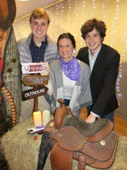 "Quinton Hardtner, ""Holiday Hoedown"" honoree Grace Poimboeuf, Spencer Hardtner pose with fun party  decorations."