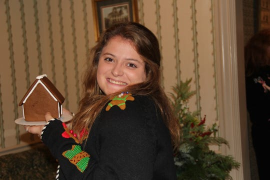Demoiselle Club Deb Mary Laura Jackson at a Gingerbread Decorating Party in her honoree Dec. 19 at the Shreveport Club.