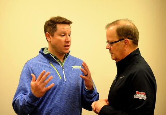 Walk-On's founder and CEO Brandon Landry talks with Duke coach David Cutcliffe during Wednesday's news conference at Independence Stadium.