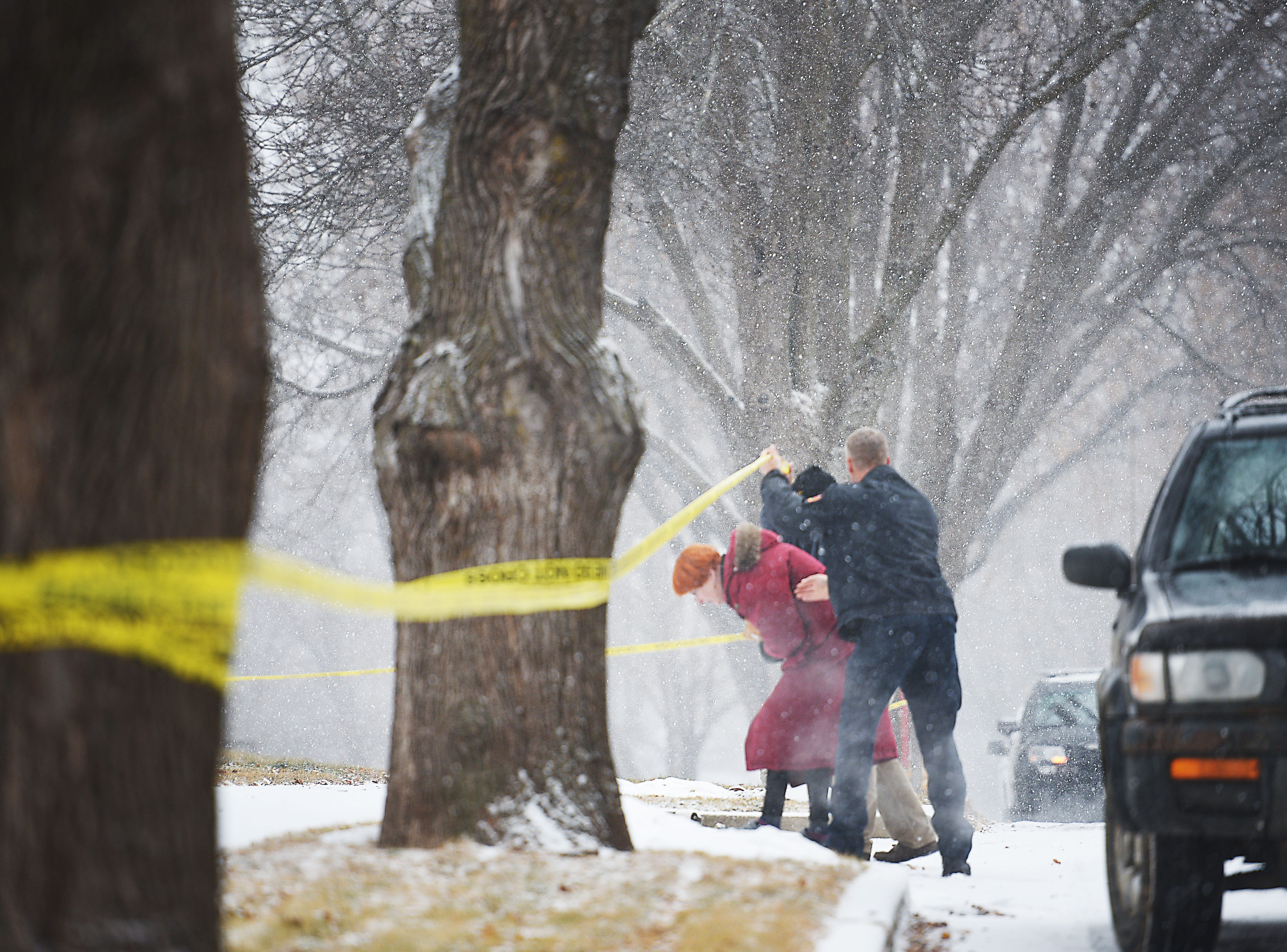 Homeowners Pat and Tim Brodkorb return to their home at 4213 S Birchwood Wednesday, Dec. 26, in Sioux Falls. A plane crashed into their backyard Tuesday night. Nearby homes were still evacuated.