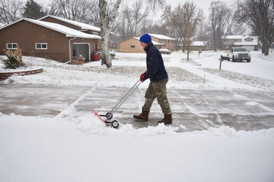 Lance Niewenhuis shovels snow out of his driveway Wednesday, Dec. 26, in Sioux Falls.