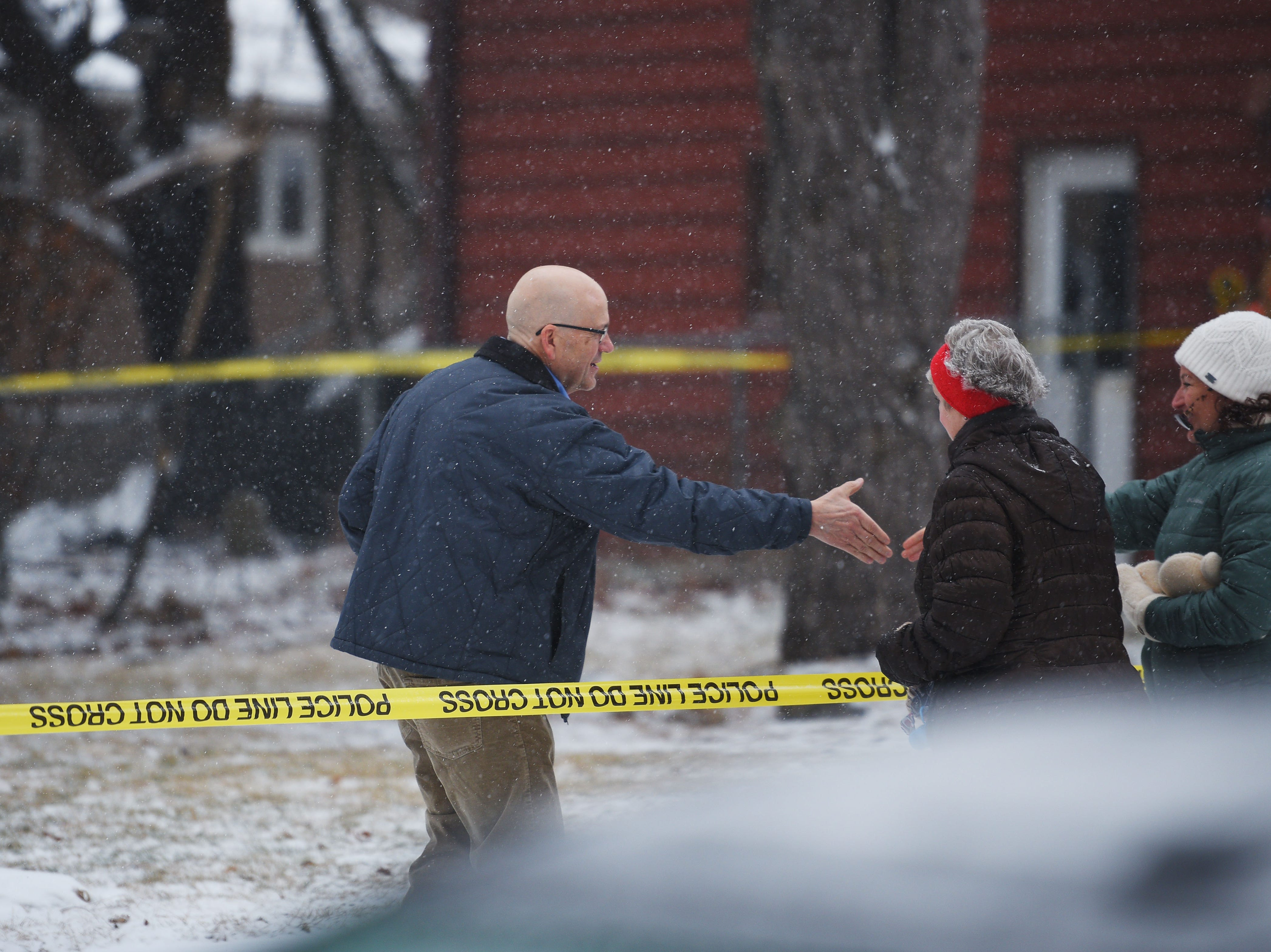 Tim Brodkorb, left, talks to neighbors who came to check in on him and his wife, Pat, at 4213 S Birchwood Wednesday, Dec. 26, in Sioux Falls. Pat and Tim Brodkorb were the first who were allowed to return home after evacuating their home last night after a plane crashed into their backyard.