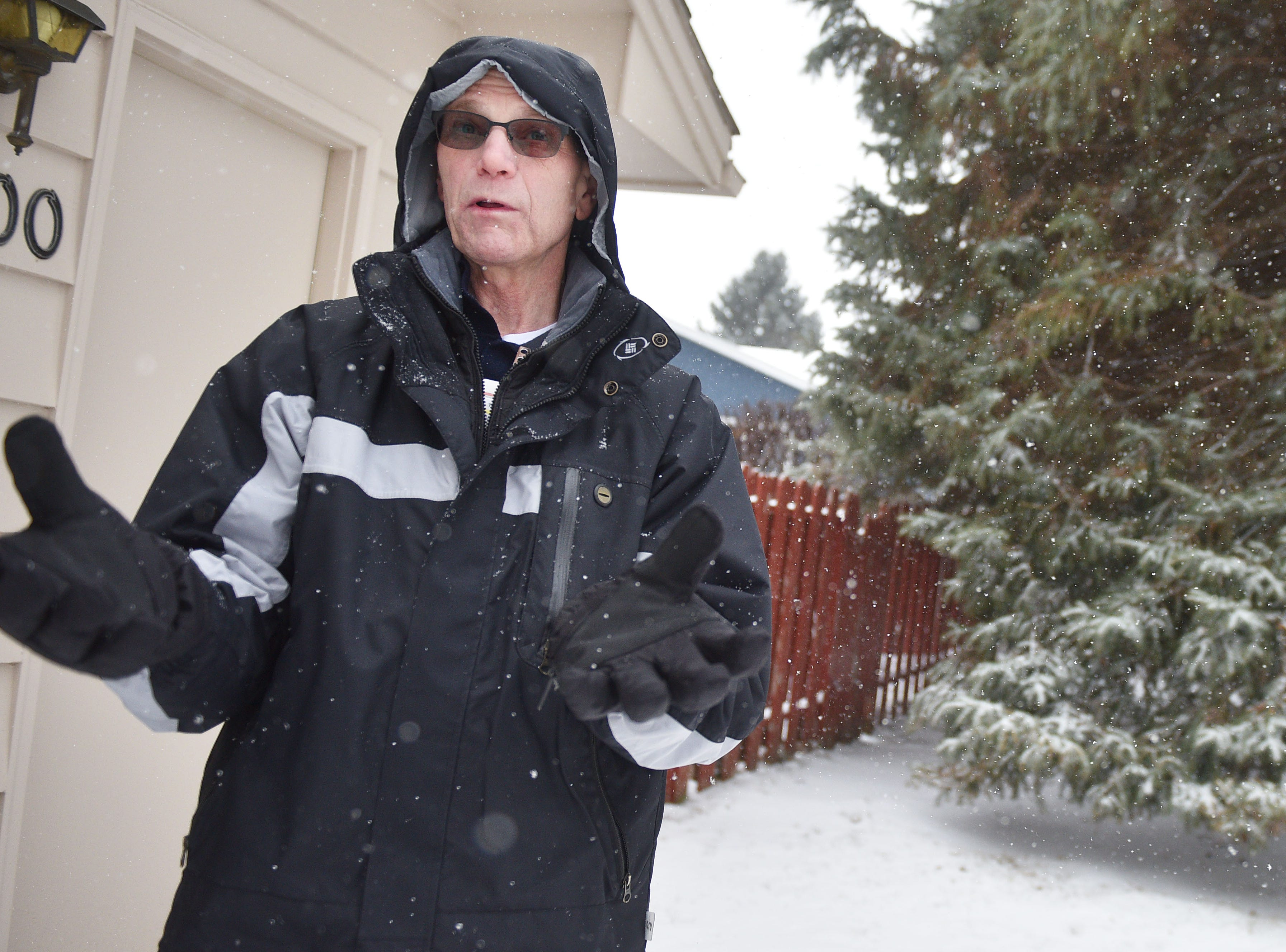 Michael Lynn talks about what he saw when he looked out his window after a plane crashed into his neighbor's yard at the 4200 block of south Birchwood Avenue Wednesday, Dec. 26, in Sioux Falls. Lynn said he saw a red and orange fire ball and noticed a plane wing.