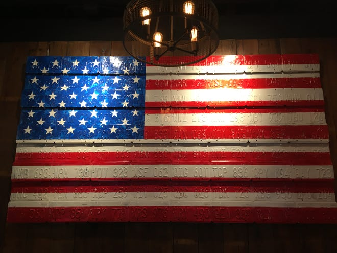 A flag made of license plates at Bricktown Brewery.