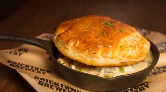 "The food at Bricktown Brewery is ""comfort food with a twist."" The Turkey Pot Pie tastes homemade and is served in a cast-iron skillet."