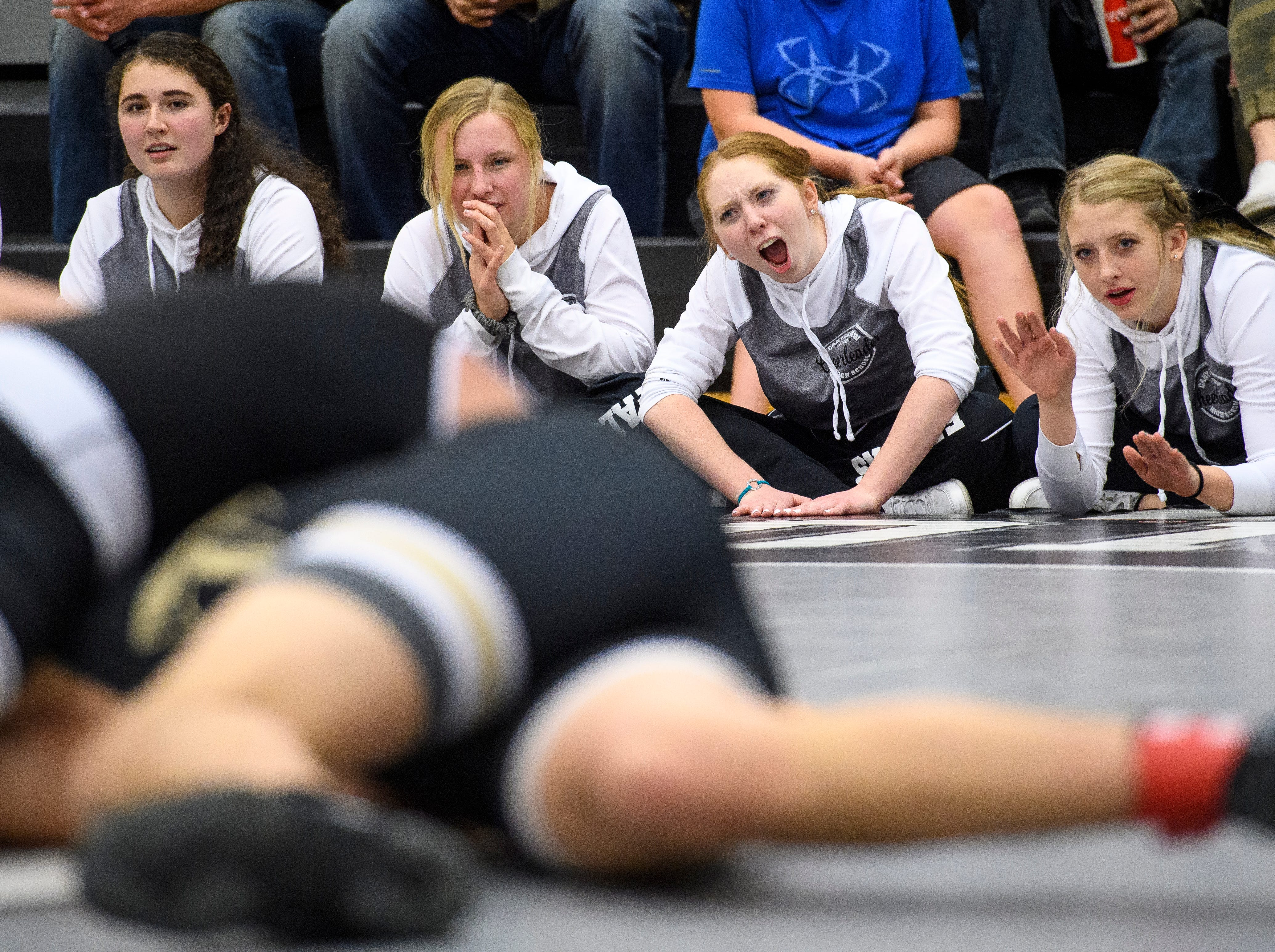 Canyon View High School cheerleaders support their team during wrestling against Desert Hills at CVHS Thursday, December 6, 2018.