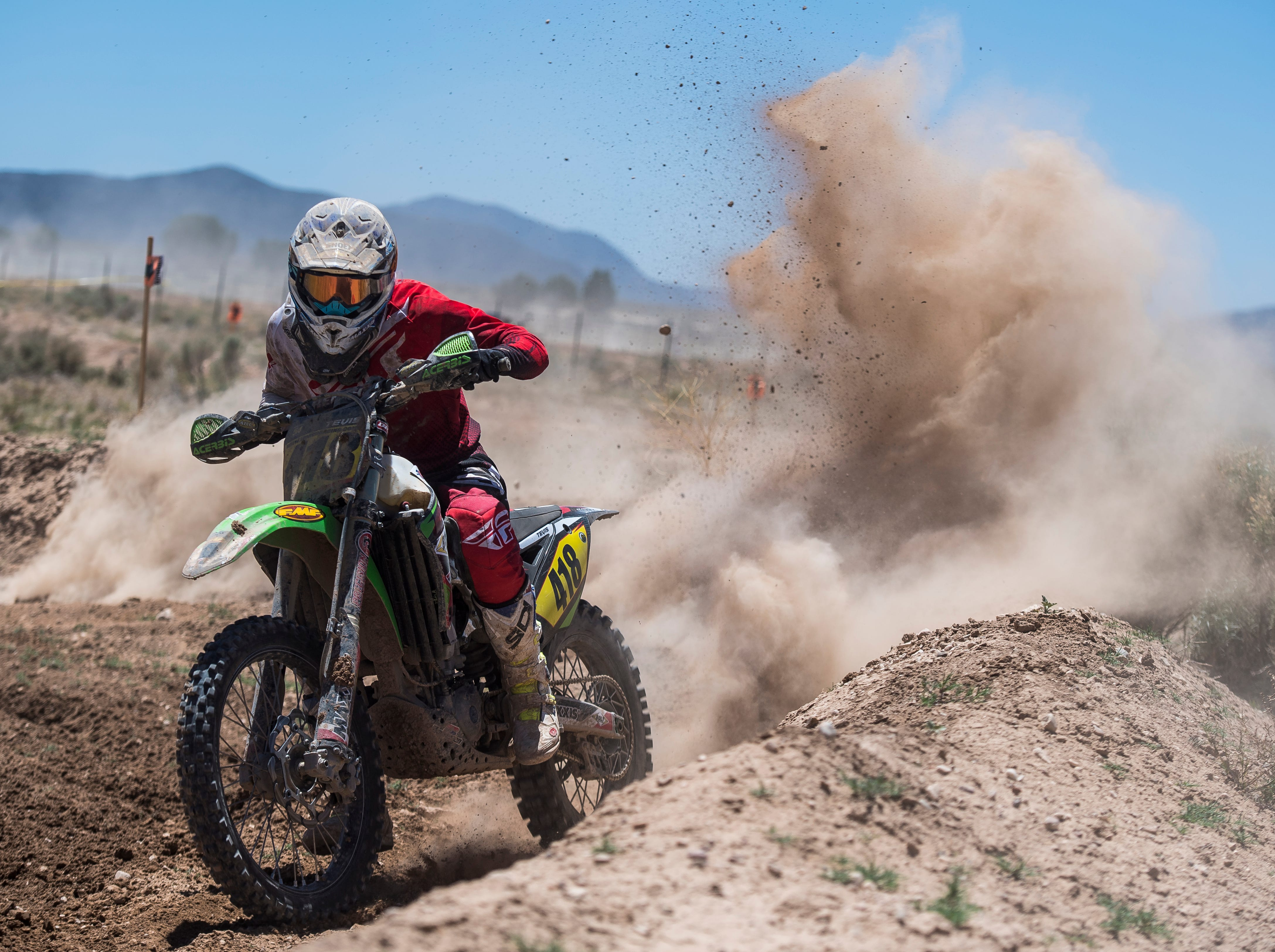 A racer compete during practice day of the World Off-Road Championship Series at Iron Mine Raceway Friday, May 25, 2018. The races will run all weekend, and feature professional drivers of Motocross, ATV, and UTV.