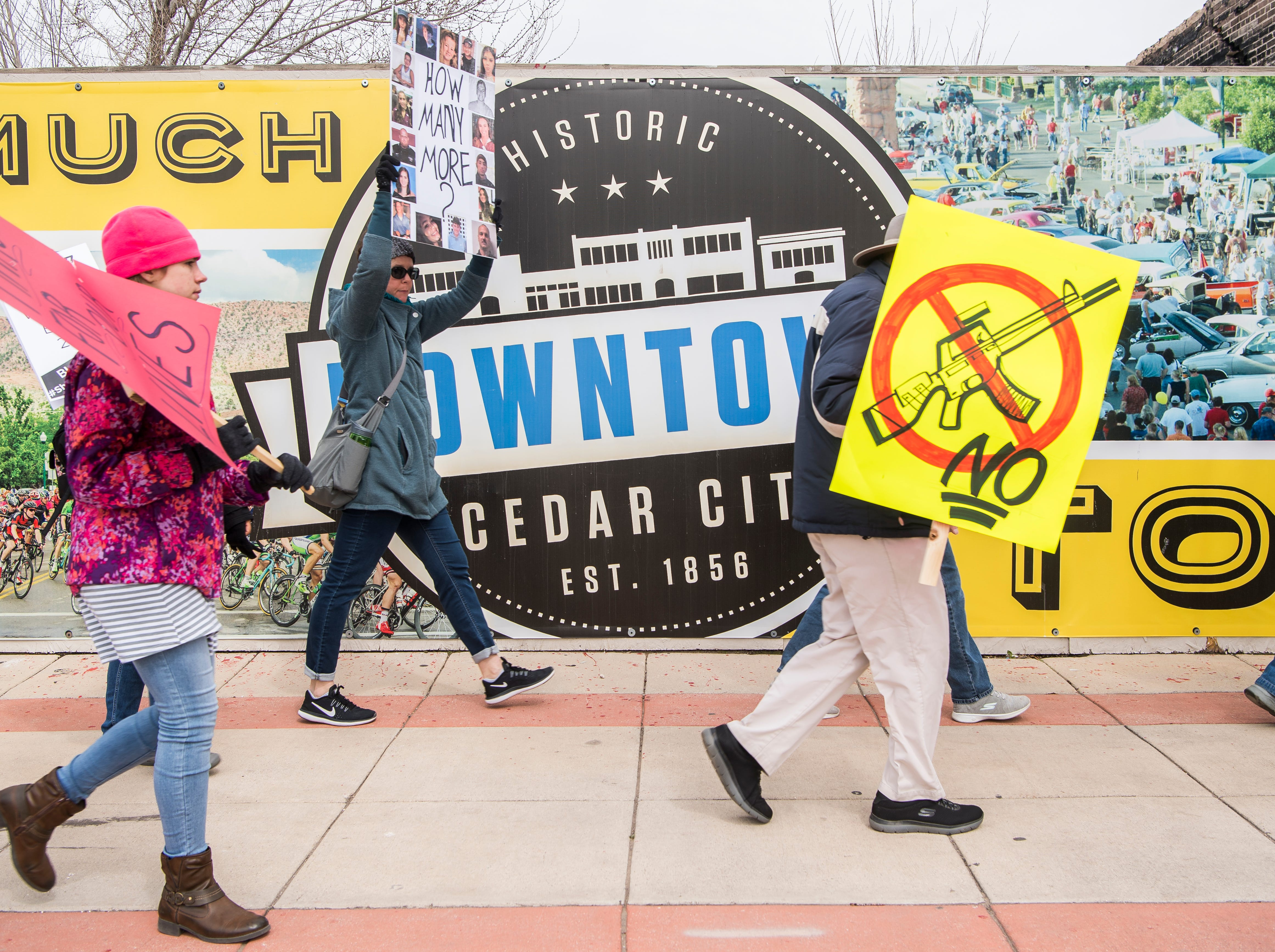 "Protestors hold signs and chant ""Enough is enough"" during the March for Our Lives protest in downtown Cedar City Saturday, March 24, 2018. More than 150 people participated in the event, which started at Southern Utah University and made its way through downtown."