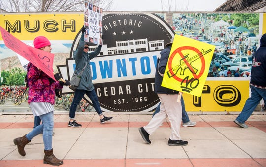 """Protestors hold signs and chant """"Enough is enough"""" during the March for Our Lives protest in downtown Cedar City Saturday, March 24, 2018. More than 150 people participated in the event, which started at Southern Utah University and made its way through downtown."""