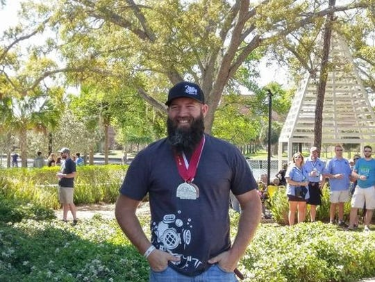 Deep Brewing Company owner/head brewer Ryan LaPete shows off his Best Florida Beer Competition bling following the Brewer's Ball in Tampa, where Deep took home two silver medals and one bronze.