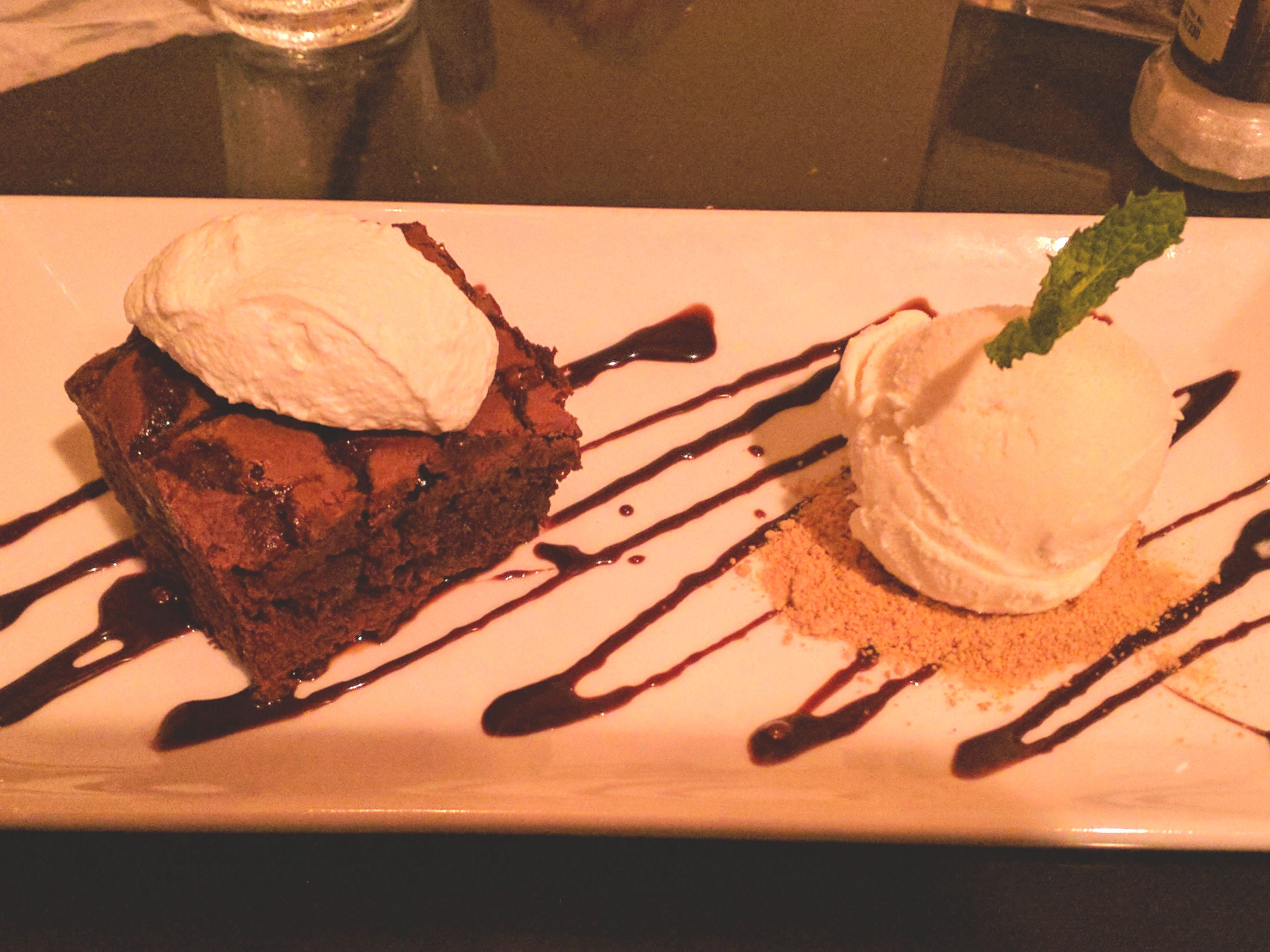 Havana Nights' brownie with whipped cream, chocolate sauce and a scoop of vanilla ice cream.