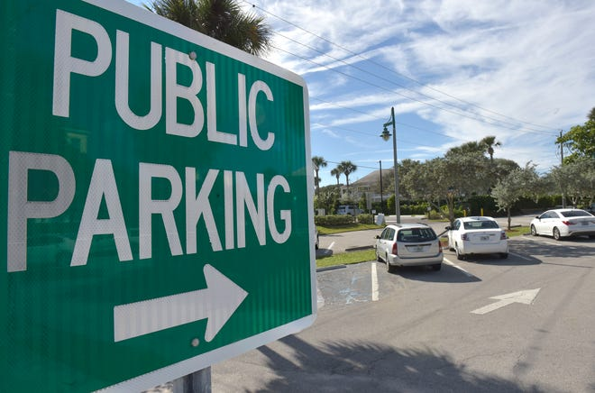 City officials are reviewing parking codes and regulations for the beachside business district on Ocean and Cardinal drives. In this December 2018 photo, the public parking lot on Ocean Drive provides limited parking.