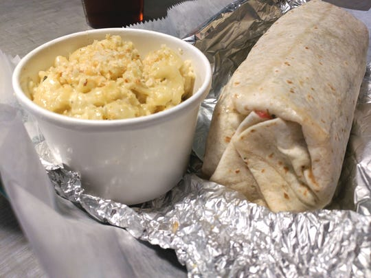 Chive's burrito was loaded with rice, beans and cheddar but made special with grilled yellow squash, broccoli, carrots, zucchini, spinach and tomatoes.  Banana peppers and fresh jalapenos, sour cream and chimichurri added lots of flavor.  The side was macaroni and cheese topped with flavored breadcrumbs.
