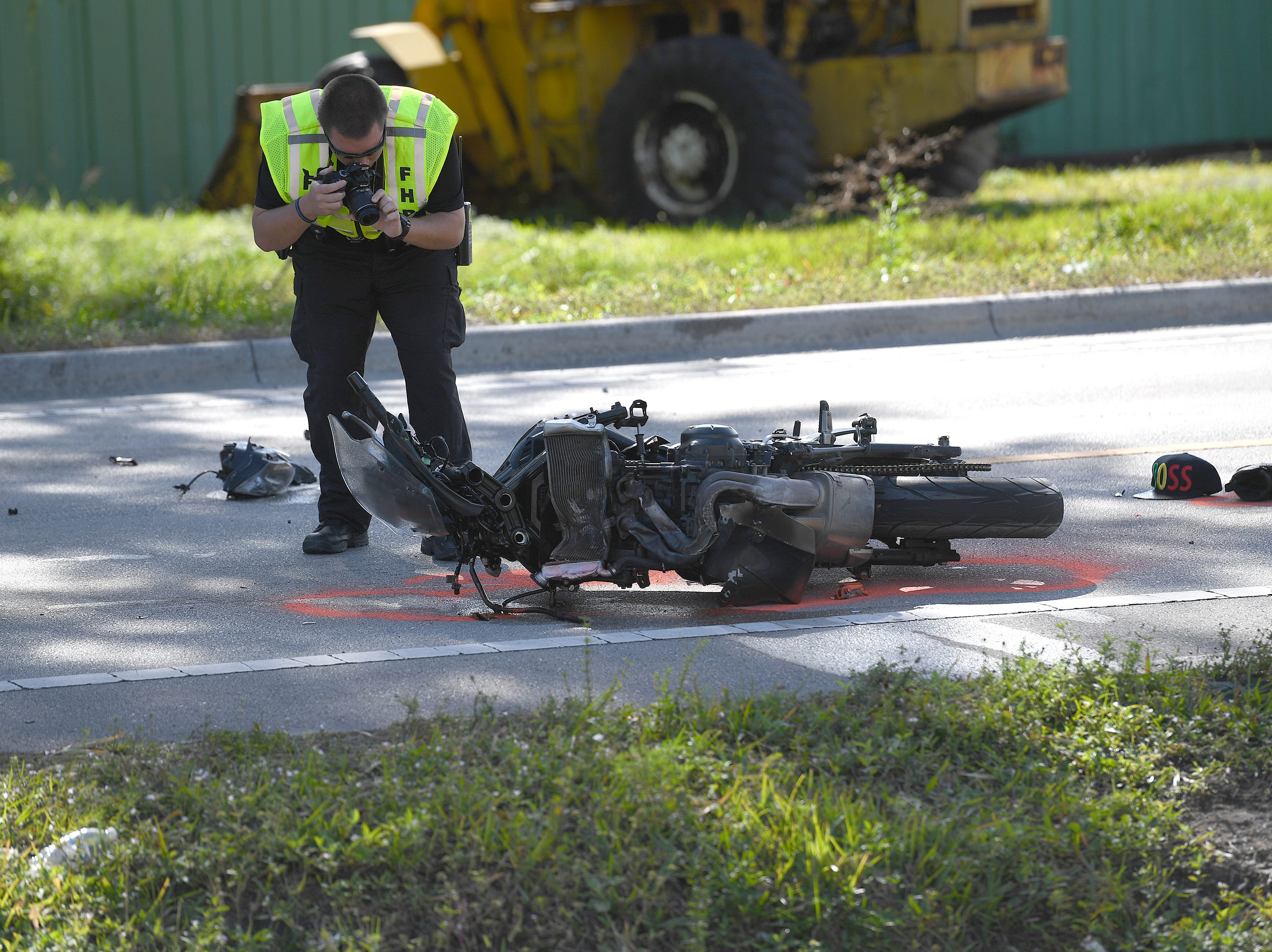 Florida Highway Patrol and Indian River County Sheriffs office investigate a crash on Wednesday, Dec. 26, 2018, involving a motorcycle and a pick up truck at the intersection of 48th Ave. and 45th St. in Gifford.
