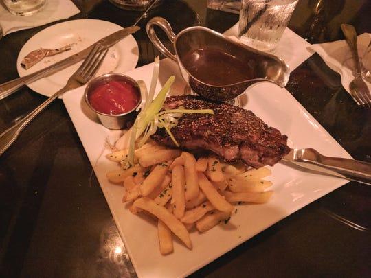 Havana Nights Piano Bar's strip steak and truffle French fries.