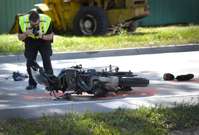 A Florida Highway Patrol investigator photographs the scene of a fatal crash on 45th Street Wednesday, December 26, 2018, involving a motorcycle and a truck at the intersection of 48th Ave. and 45th Street in Indian River County.