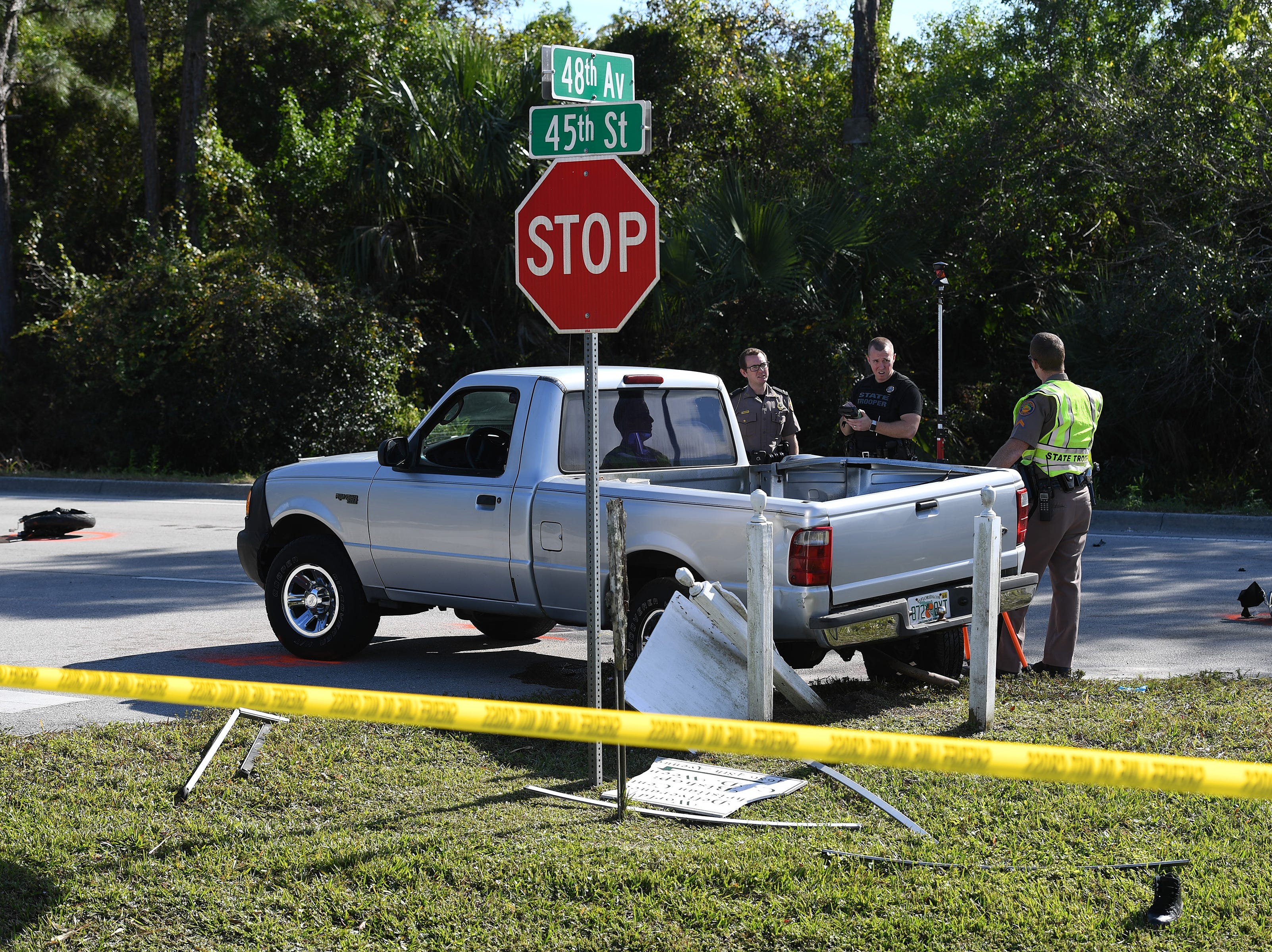 Florida Highway Patrol and Indian River County Sheriffs Office investigate a crash involving a motorcycle and a pick up truck on Wednesday, Dec. 26, 2018, at the intersection of 48th Ave. and 45th St. in Gifford.