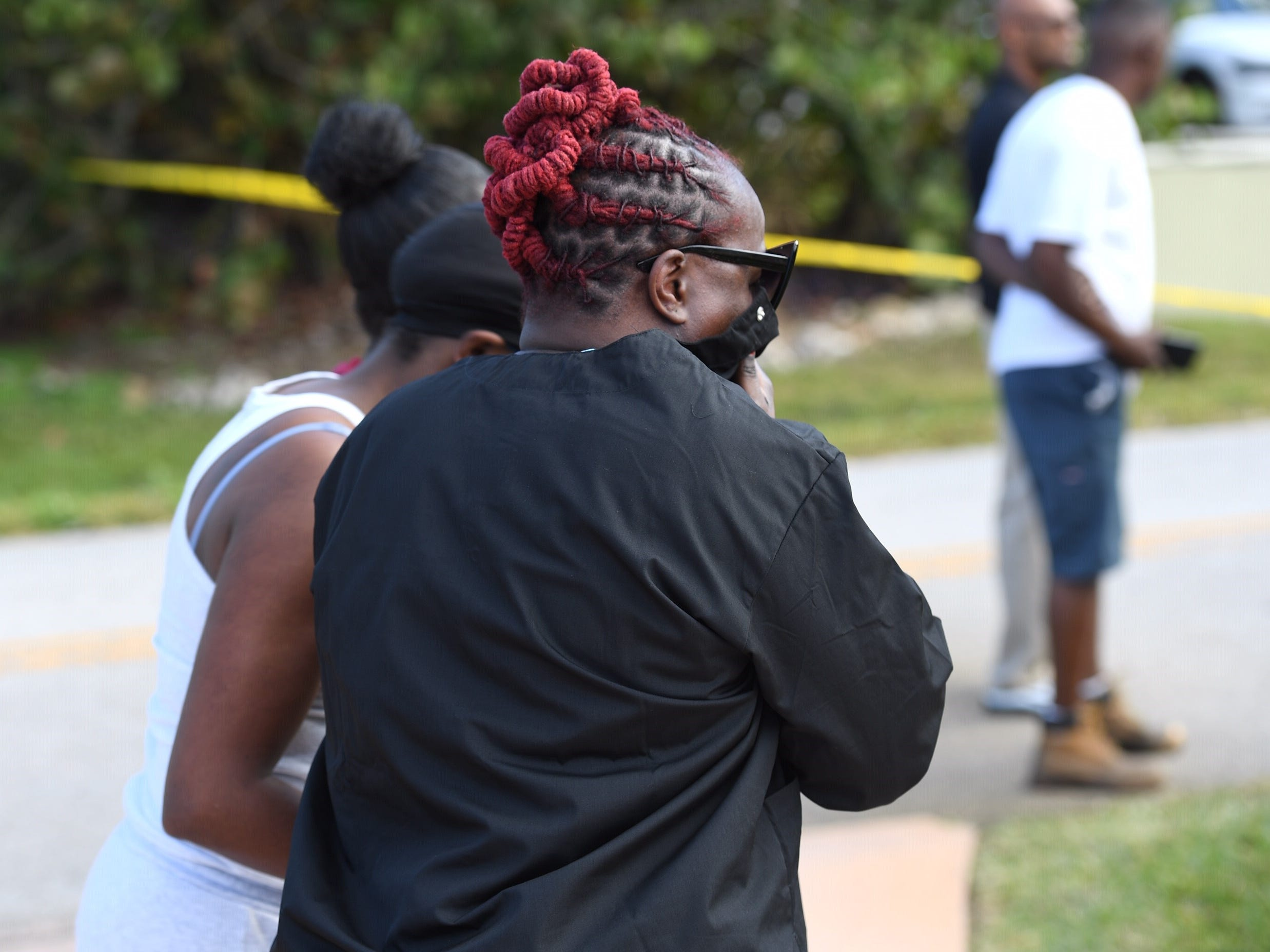 Shawn Latrice, a friend of the motorcyclist, looks over the scene as  Florida Highway Patrol and Indian River County Sheriff's Office investigate the crash involving a motorcycle and a pickup truck at 48th Avenue and 45th Street in Gifford.