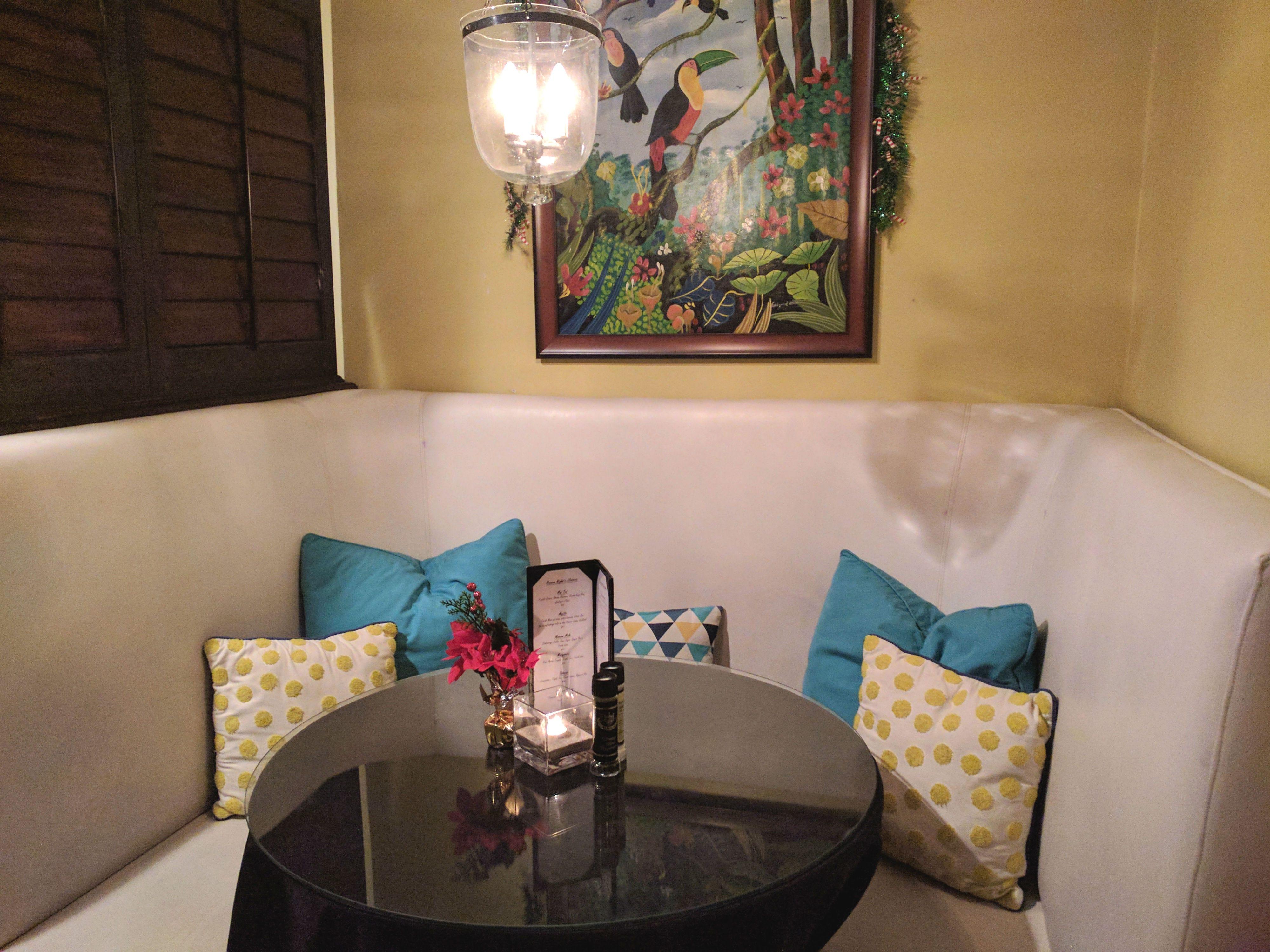 A cozy banquette at Havana Nights Piano Bar in Vero Beach.