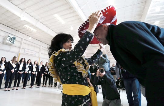 Stanford head coach David Shaw receives the ceremonial sombrero during the welcome party for the Cardinal Wednesday at the Atlantic Aviation.