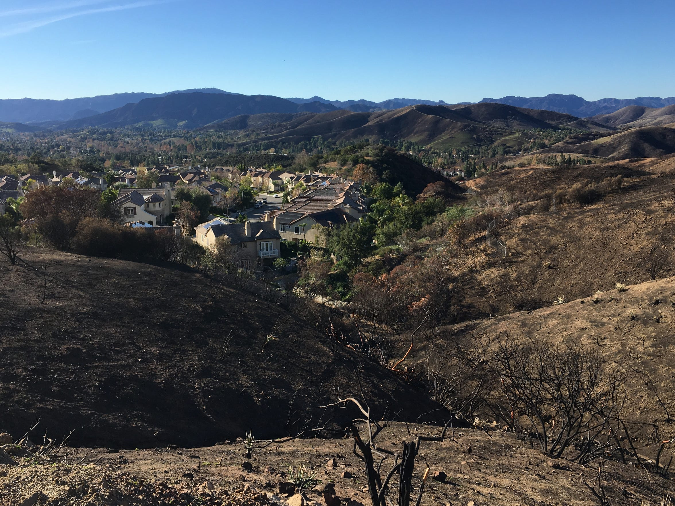 Oak Park homes sit below hillsides burned in the Woolsey Fire in November.