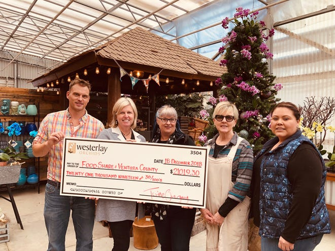 Toine Overgaag and Westerlay Orchids' retail team present Monica White, FOOD Share of Ventura with a $21,030.19 check from proceeds from a weeklong sales event. Shown are Overgaag, Monica White of FOOD Share, Nancy Gallagher, Paige Harman and Mayra Romero.