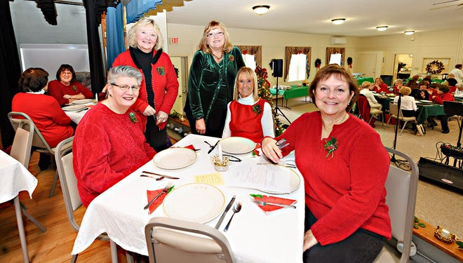 Club members (from left) Marcella Camp, Joan Cooper, Rosemary Lambert, Judy Crowe and Katie Coltri visit during the annual holiday luncheon.