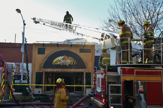 Fire crews work to contain a three-alarm fire that damaged six downtown Visalia businesses, including Pacific Treasures & Gourmet, on Dec. 26, 2018.