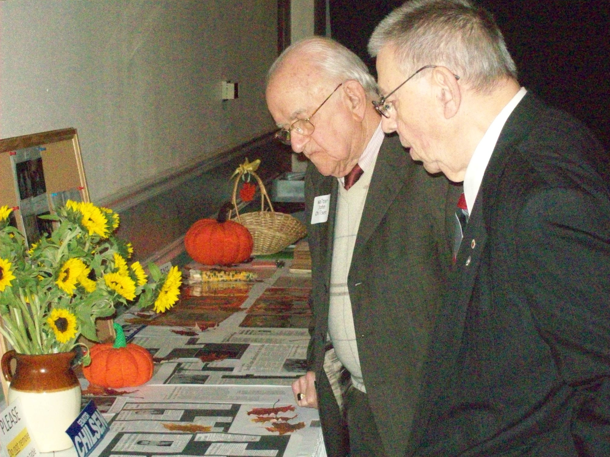 Walter John Chilsen, left and long-time friend, Robert Kasmerchak, look at old newspaper clippings Friday, Nov. 4, 2011, that detailed Chilsen's 24-year career in the Wisconsin senate during a celebration Friday of Chilsen's life and upcoming 88th birthday.