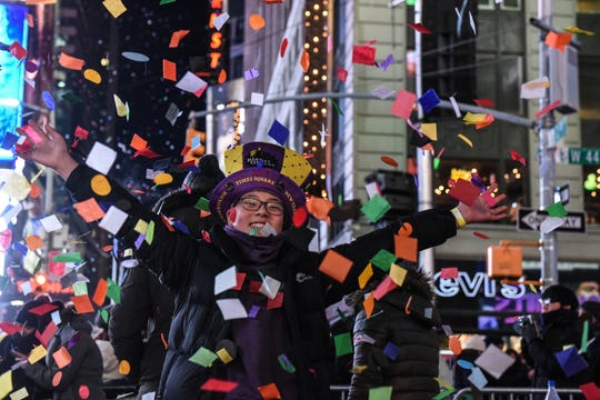 People throw confetti on New Year's Eve in Times Square on Jan. 1.