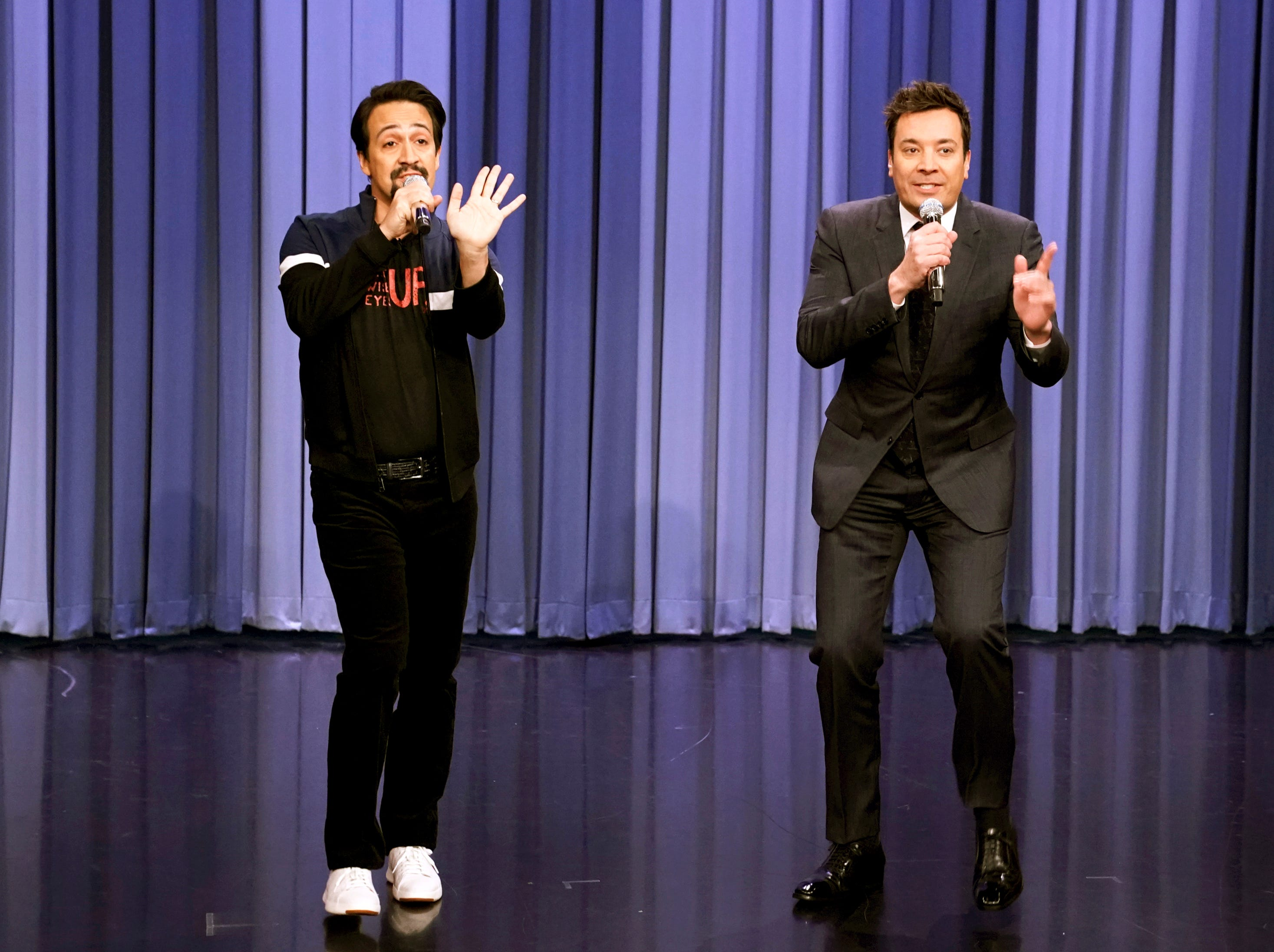 """This Dec. 17, 2018 photo released by NBC shows Lin-Manuel Miranda, left, and host Jimmy Fallon performing a medley of popular songs with altered lyrics for the holiday season on """"The Tonight Show Starring Jimmy Fallon,"""" in New York.  Fallon announced Monday that he will do a special episode from Puerto Rico on January 15. The telecast, in which Miranda will appear, will focus on the spirit and culture of Puerto Rico in its efforts to rebuild and raise awareness following the devastating hurricane that struck the U.S. territory on Sept. 20, 2017.  Miranda will reprise his lead role in the musical """"Hamilton"""" from Jan. 8-27 at the University of Puerto Rico to raise money for the Flamboyan Arts Fund. (Andrew Lipovsky/NBC via AP) ORG XMIT: NYET215"""