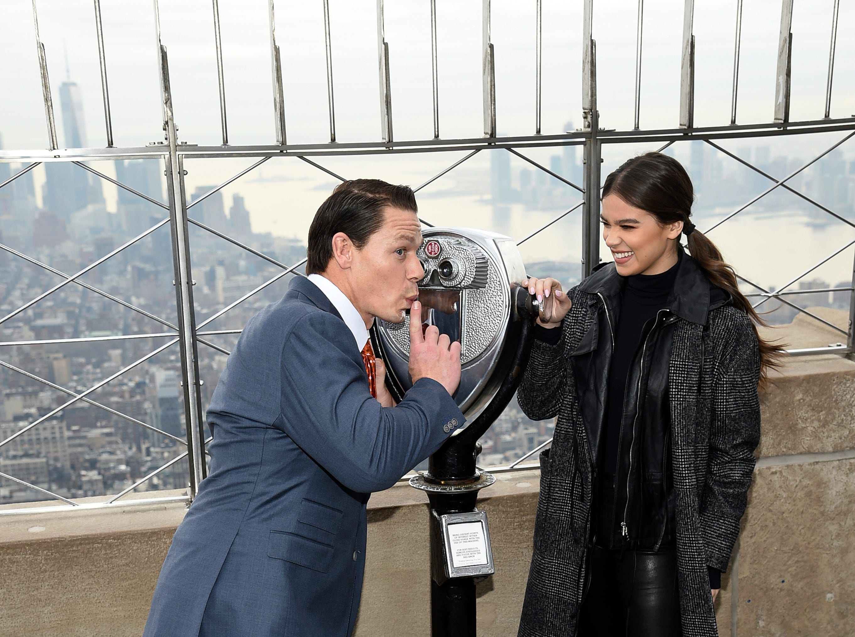 Actors John Cena, left, and Hailee Steinfeld pose together on the 86th floor observation deck at the Empire State Building in support of the Make-A-Wish Foundation on Thursday, Dec. 20, 2018, in New York. (Photo by Evan Agostini/Invision/AP) ORG XMIT: NYEA105
