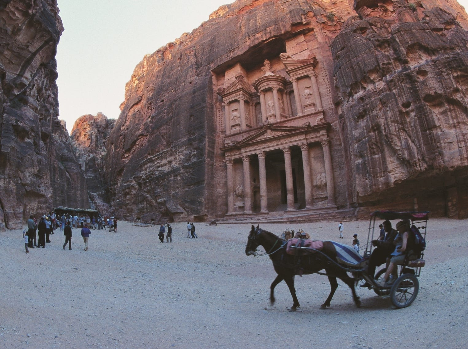 Petra is Jordan's ancient city carved from pink stone. Visitors enter through a twisty mile-long gorge called the Siq.