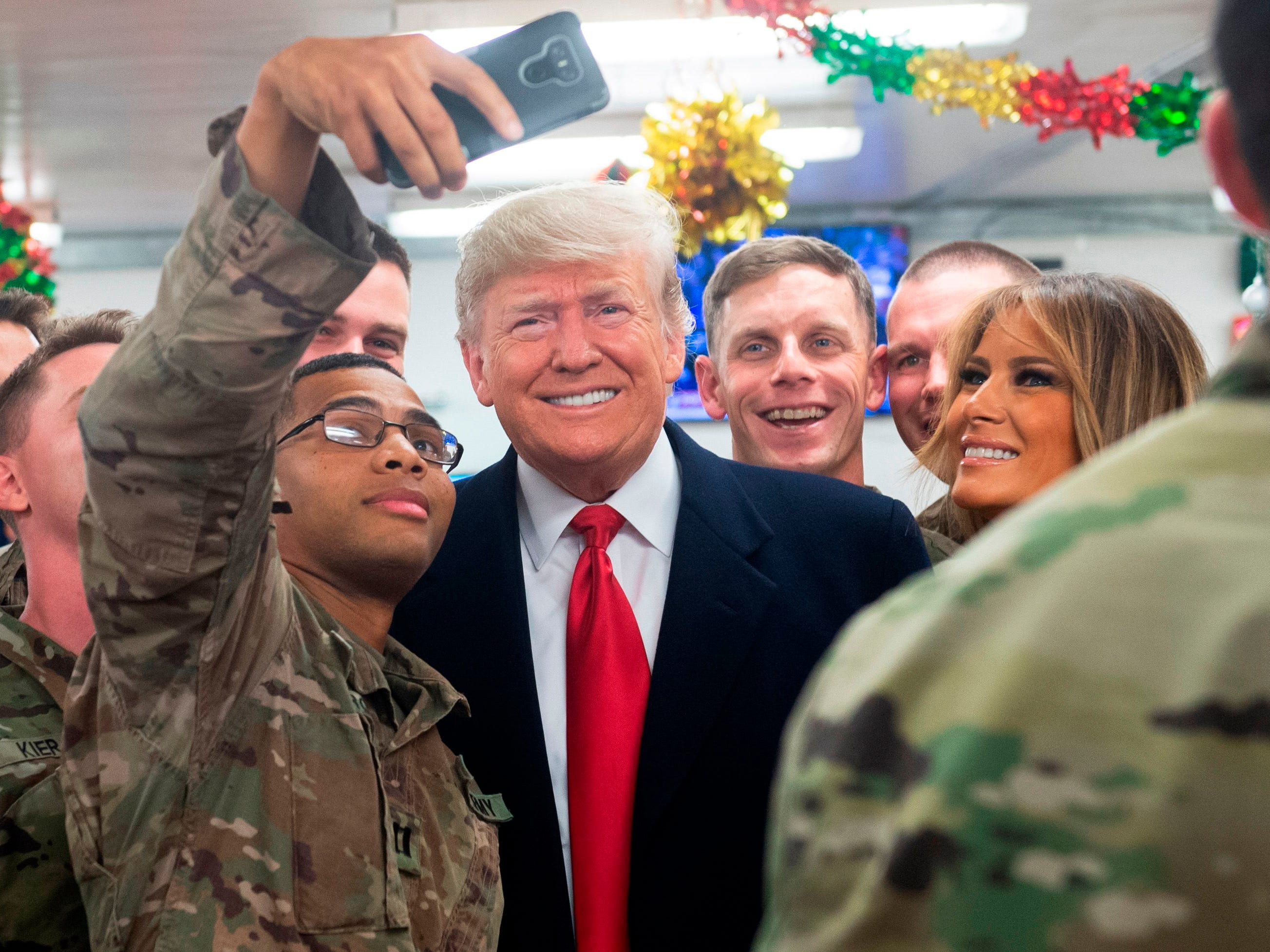 US President Donald Trump and First Lady Melania Trump greet members of the US military during an unannounced trip to Al Asad Air Base in Iraq on December 26, 2018. (Photo by SAUL LOEB / AFP)SAUL LOEB/AFP/Getty Images ORIG FILE ID: AFP_1BU3JB