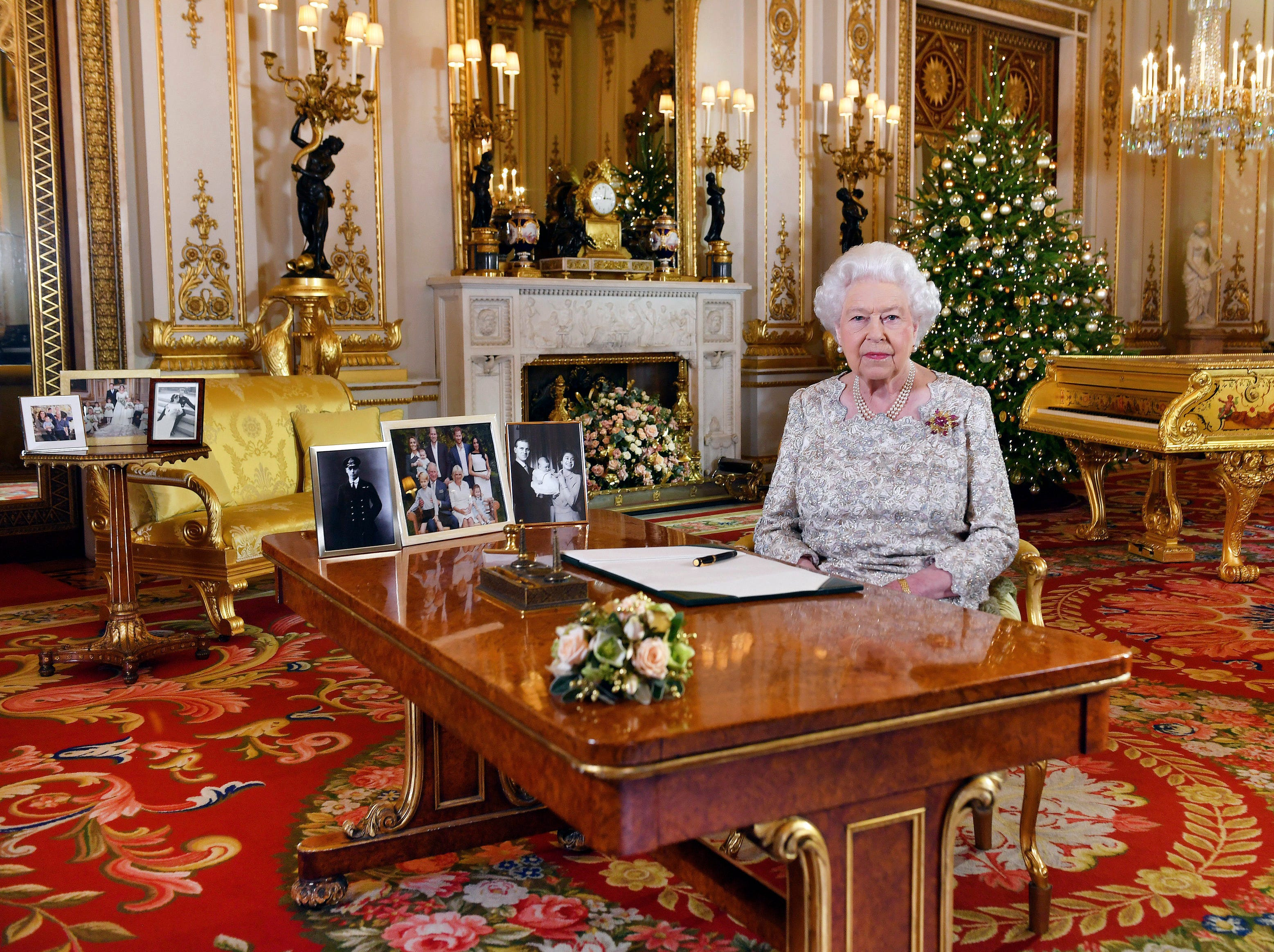 In this image released on Tuesday, Dec. 25, 2018, Britain's Queen Elizabeth poses for a photograph after she recorded her annual Christmas Day message, in the White Drawing Room of Buckingham Palace, London. (John Stillwell/Pool via AP) ORG XMIT: LLT504