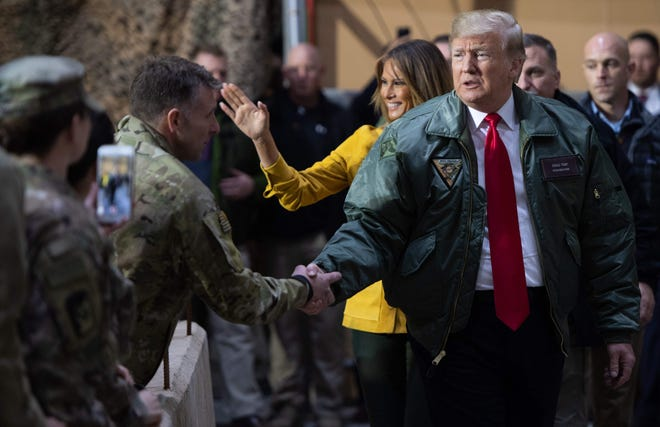 President Donald Trump and first lady Melania Trump visit Joint Base al Asad in Iraq on Dec. 26, 2018.