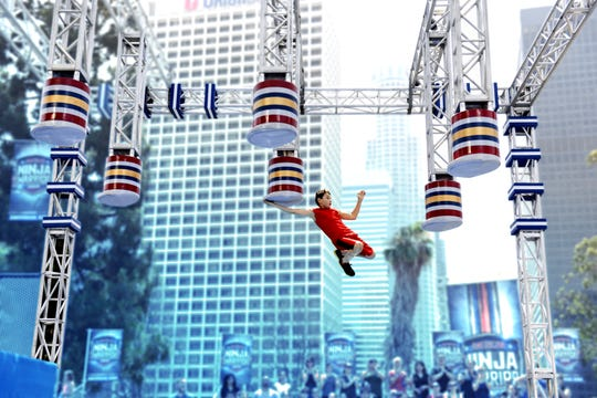 A young contestant competes on Universal Kids' 'American Ninja Warrior Junior.'