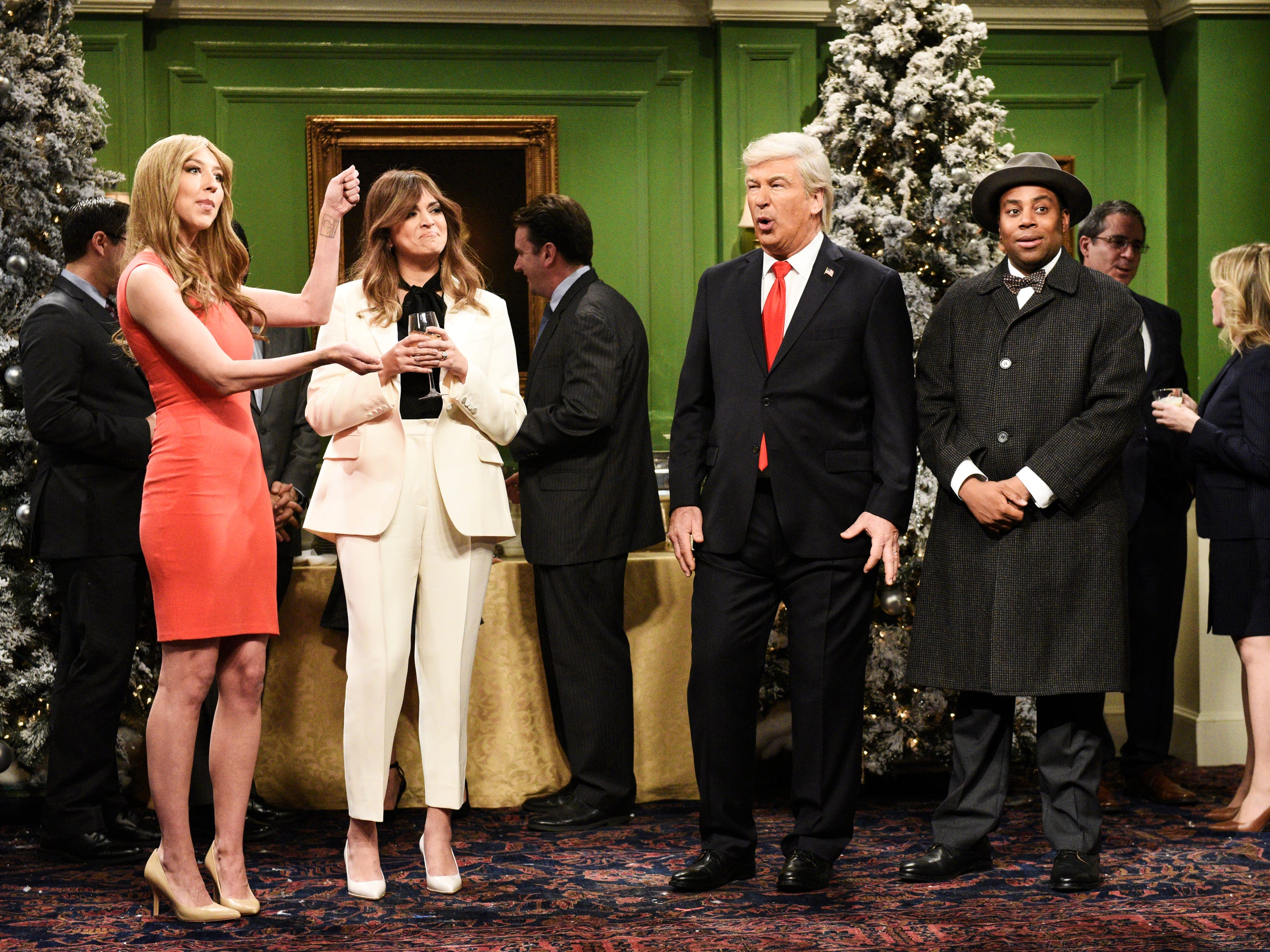 """SATURDAY NIGHT LIVE -- """"Matt Damon"""" Episode 1755 -- Pictured: (l-r) Heidi Gardner as Hernia Trump, Cecily Strong as Melania Trump, Alec Baldwin as Donald Trump, and Kenan Thompson as Clarence the angel during the ?It?s a Wonderful Trump? Cold Open in Studio 8H on Saturday, December 15, 2018 -- (Photo by: Will Heath/NBC) ORG XMIT: Season:44 [Via MerlinFTP Drop]"""