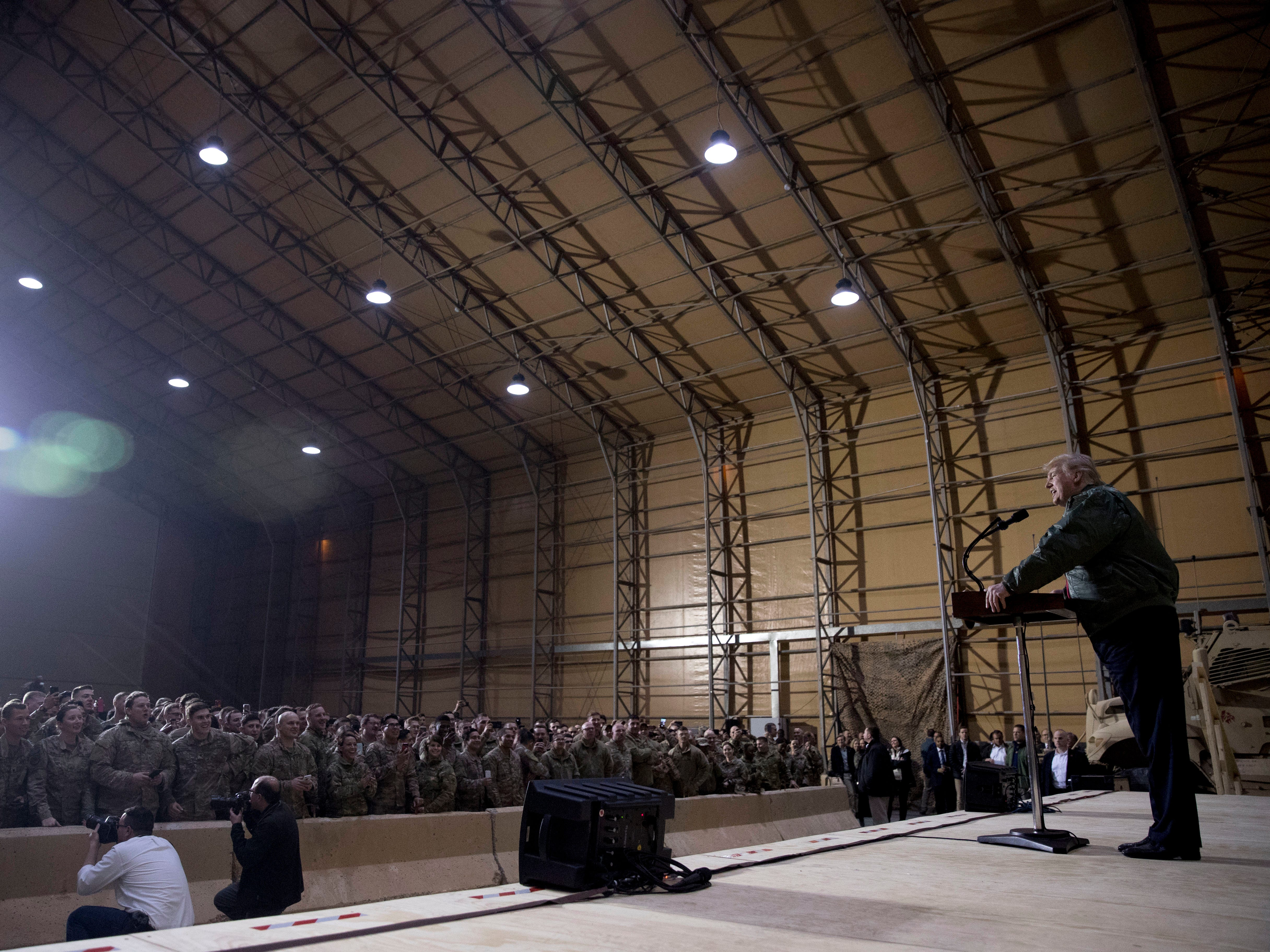 President Donald Trump speaks at a hanger rally at Al Asad Air Base, Iraq, Wednesday, Dec. 26, 2018. President Donald Trump, who is visiting Iraq, says he has 'no plans at all' to remove US troops from the country. (AP Photo/Andrew Harnik) ORG XMIT: IRQA203